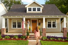 Joel and Rachel Banta transformed the sad facade of their 1920s house by centering the new door—built by Rachel's carpenter dad-—and reinstating the original dormer. New, Craftsman-style piers replaced old metal railings.