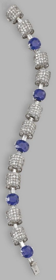An Art Deco platinum, diamond and sapphire bracelet, Italian, Circa 1935. Cushion-shaped sapphires weighing approximately 13.50 carats, single-cut and baguette diamonds weighing approximately 13.00 carats, length 7 inches, Italian maker's mark 44 fasces symbol MI. #ArtDeco #bracelet