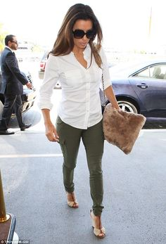 Precious cargo: Eva Longoria wore a pair of tight green cargo pants as she prepared to fly out of LAX airport on Tuesday afternoon