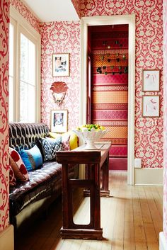 So many great wallpapers out there! This bold red and orange patterned wallpaper with light wood floors looks great. It's ok to mix patterns!