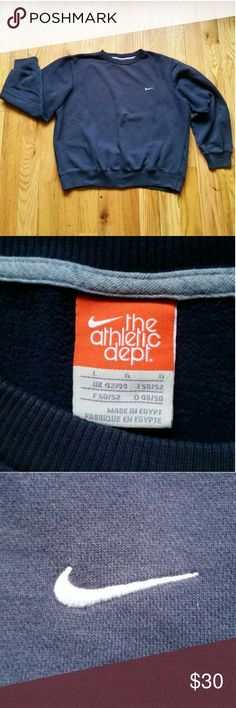 Nike Athletic Dept. Navy Men's Classic Crew Neck Nike Athletic Dept.  Navy Men's Classic Crew Neck Sweater Fleece (341570-405). Classic, clean Nike swoosh embroidered on the left side. Soft, fleece like interior. Long sleeves with ribbed cuffs. Ribbed neck and waist. Used. Clean, no rips, no stains but color slightly faded.   24 inches from neck to hem. 27 from armpit to armpit. Nike Shirts Sweatshirts & Hoodies