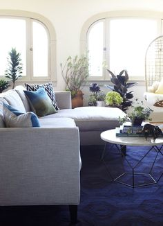 I Love The Contrast Of Rich Blue Carpet And Light Walls Cleaverly Accesorised With Living RoomsLiving Room