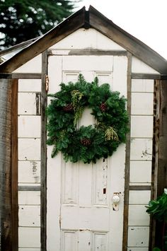 SEASONAL – CHRISTMAS – during the holiday season, new englanders take time to trim the outdoors in creative ways with beautiful holiday decor, including a holiday wreath on the back yard shed.