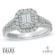 This ring features a magnificent 1/2 ct. emerald-cut diamond center stone glittering in a rectangular double frame set with round accent diamonds.