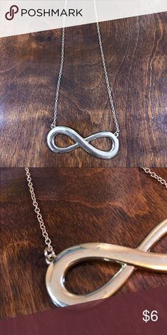 Infinity Necklace Chain length approximately 8 inches. Looks silver in the first pic but is actually more of a gold. There is one tiny blemish as shown in the second pic, but it's so small that it's not noticeable at all (and hard to even capture on camera). Open to reasonable offers. ☺️ No trades please. 💞 **Remember, 15% off bundles of 2 or more!** Jewelry Necklaces