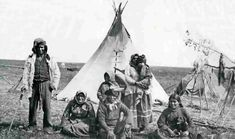 Black Bird (Son of White Cap) standing far left with White Cap seated in center and family - Sisseton 1885.