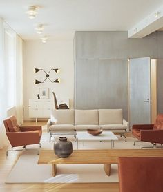 "Shelton, Mindel & Associates conceived and arranged a Manhattan loft for Claude Arpels. ""The gestures of the design are in keeping with the original industrial vernacular of the building,"" explains Lee F. Mindel. Near a Poul Kjaerholm armchair and sofa in the living room is a Charlotte Perriand wood bench. ""Most of the furnishings we chose are by architects who understood the technology of their time. Their design philosophies are present in the furniture,"" Peter L. Shelton says."