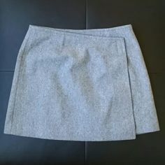 ✨HP✨ EXPRESS wool mini wrap skirt Light gray skirt. Velcro closure on left side that opens up and button on inside to keep dress on. Wore one time and in great condition. 70% wool 26% nylon 4% other fibers Express Skirts