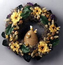 This great summer beehive wreath will look great hanging on your door. It's a quick and easy DIY craft anyone would love to have in their home. Don't worry, these bees won't sting. Summer Flower Arrangements, Summer Flowers, Floral Arrangement, Bee Crafts, Flower Crafts, Bee Skep, Bee Hives, Diy Wreath, Wreath Making