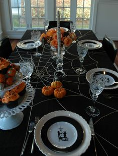 a stylish halloween table setting halloween table black placemats and black spray paint - Halloween Table Setting