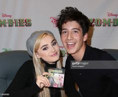 Actors Meg Donnelly (L) and Milo Manheim attend a soundtrack signing for Disney Channel's 'Zombies' at Barnes & Noble at The Grove on February 25, 2018 in Los Angeles, California.