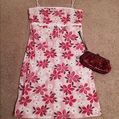 Pink floral spaghetti strap dress Pink, Girly & Flirty! Spaghetti straps, empire waist with a bow (for appearance)   Perfect for summer, cruise, themed party, etc. Great condition!! Rave city Dresses
