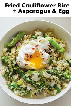 Whoever came up with the idea of cauliflower rice should get a medal. Its so delicious and fast. I love to mix the runny egg into my rice as a sauce. Egg Recipes, Whole Food Recipes, Cooking Recipes, Cooking Rice, Cooking Games, Cooking Turkey, Cooking Videos, Shrimp Recipes, Brunch Recipes