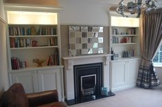 Fitted alcove storage with plaster archway above