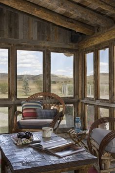 Loving this rustic log cabin screened porch… it looks to be the perfect sunny spot to curl up and read with a cup of tea (via Design Associates - Lynette Zambon, Carol Merica)