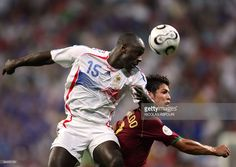 French defender Lilian Thuram (L) heads the ball in front of Portuguese forward Cristiano Ronaldo (R) during the World Cup 2006 semi final football game Portugal vs. France, 05 July 2006 at Munich stadium.