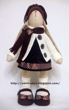 Oh, how I love this smart rabbit girl soft toy. Comes with free pattern. It's a modified Tilda Rabbit pattern. With flat paws, so it can stand up.