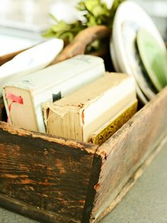 A kitchen can never have too much storage. Utilize wire market baskets, wooden crates, tool caddies and antique jars with zinc lids as stylish organizers. They're great for displaying pretty linens, family cookbooks, serving platters, flatware, produce and dry goods. Look for pieces that are in sturdy, usable condition and scaled right for the space. For instance, an oversize dough bowl would be fabulous on a huge island, but it would overwhelm a small galley kitchen.
