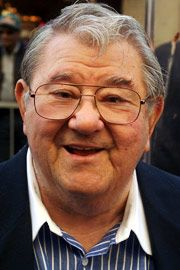 "Buddy Hackett -- (8/31/1924-6/30/2003). American Comedian, Broadway Actor, Voice Artist & Game Show Panelist.  Movies -- ""All Hands on Deck"" as Shrieking Eagle Garfield, ""It's A Mad, Mad, Mad, Mad World"" as 'Benjy' Benjamin, ""Muscle Beach Party"" as S.Z. Matts, ""The Love Bug"" as Tennesseee Steinmetz, ""Scrooged"" as Scrooge. Center Square on Game Show the Original ""Hollywood Squares"". He died at his Beach House, He was suffering from Diabetes & Stroke, age 78. Born: Leonard Hacker."