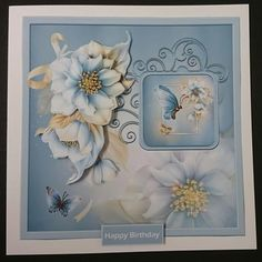 Winter florals 7x7 card with decoupage by Sue Soules I printed the sheet onto satin photo paper. Cut out the main picture and attached it to a white card blank. The decoupage was added using foam pads.