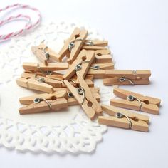 These super-cute mini sized wooden pegs are ideal for gift wrapping and craft projects. Choose from natural or white coloured pegs. - Perfect for sealing paper favour bags - Gorgeous on wrapped presen. Hanging Kids Artwork, Thoughtful Gifts For Him, Wedding Favor Bags, Wooden Pegs, Party Packs, How To Make Paper, Gift Bags, Craft Projects, Wraps