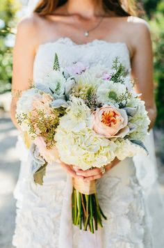 Proof that casual can still be breathtaking: a hand-tied bouquet of hydrangeas, roses and bright greens.
