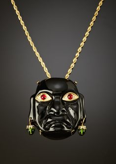 sort of love it, sort of creeped out by it. Kenneth Jay Lane - Buddha Pendant