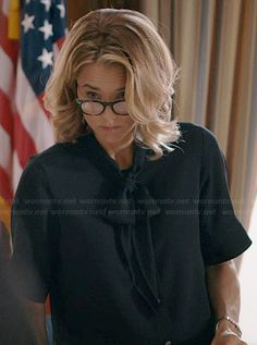 Elizabeth's black short sleeved neck tie blouse on Madam Secretary.  Outfit Details: http://wornontv.net/40542/ #MadamSecretary