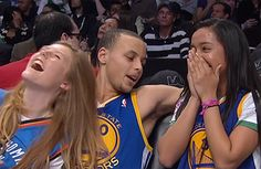 Stephen Curry, at the bench, with 2 girls. :)