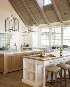 Breathtaking traditional French Country kitchen in modern French farmhouse (Normandy style) in California by Giannetti Home. White oak flooring and cabinets, plaster walls, oversize lanterns, two islands, and farm sinks. Modern French Kitchen, French Country Kitchens, Modern Farmhouse Kitchens, Farmhouse Kitchen Decor, Home Kitchens, French Farmhouse, Country Farmhouse, Country Bathrooms, French Cottage