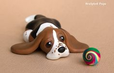Bored Basset hound pup sculpture by SculptedPups on DeviantArt Polymer Clay Kunst, Polymer Clay Figures, Polymer Clay Sculptures, Polymer Clay Animals, Cute Polymer Clay, Cute Clay, Polymer Clay Projects, Polymer Clay Creations, Sculpture Clay