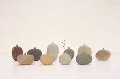 """Stone Vases by Mitsuru Koga, $380. Sizes and colors vary, hand carved from natural stones. Approximately 1"""" to 2"""" in height."""