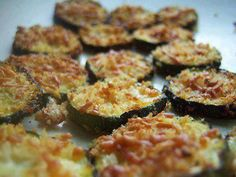 """Zucchini Parmesan Crisps 1 lb. zucchini or squash ~2 med 1/4 c. shredded parmesan (heaping) 1/4 c. Panko breadcrumbs (heaping) 1 Tbls olive oil 1/4 tsp kosher salt & fr.gr.pepper Preheat 400 Line 2 baking sheets w/foil & coconut oil, or olive or veg.spray Toss 1/4"""" thick slices w/oil. Combine breadcrumbs, parm, s Coat both sides pressing in. Will not completely cover, but ok. Place in a single layer, sprinkle remaining over. Bake about 22 to 27 min, until golden brown. no need to flip."""