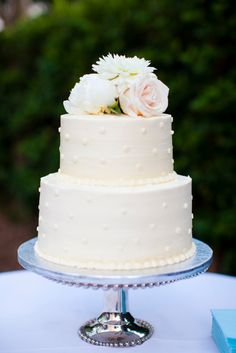 Two-Tier Polka Dot Buttercream Wedding Cake | Whole Foods Market https://www.theknot.com/marketplace/whole-foods-market-mount-pleasant-sc-303386 | Karson Photography https://www.theknot.com/marketplace/karson-photography-charleston-sc-277724