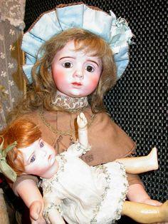 A. Marque doll in the Odin collection - Musée de la Poupée-Paris. Holding a #248 SFBJ character.