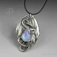 Heres an idea for a book... girl finds dragon and they are connected by family heirloom, an amulet... so doing that!