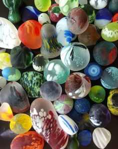 "multi-colored sea glass. Some of these could be ""end of day"" pieces that glassmakers would toss into the sea at day's end for convenience..."