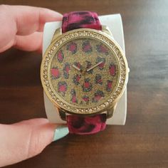 Animal Print Watch Super adorable animal print watch. Faux calf hair strap , glitter face and rhinestones around the dail. Needs new battery. Never worn. Boutique Accessories Watches