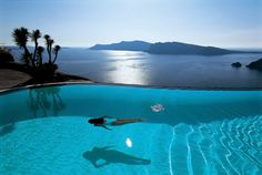 The infinity pool at Perivolas, on the Greek island of Santorini, appears to drop straight into the Aegean below.