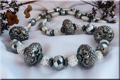 silver and hematite