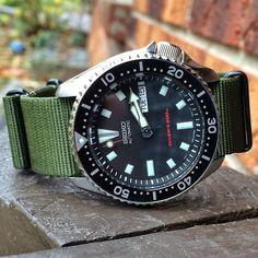 Wearing the #skx173 today on olive drab. #Seiko #wus #wristporn #watchuseek #watches #Diver #watchfreak #watchfam #WIS #watch #womw #klocksnack #edc #essentials #sakphotographics #JDM #Japan #watch #seikodivers #nato #strapnerd #Strap #Pepsi #SKX007 #skx009J #skx009 #notHSummit by sakroll