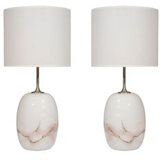 http://www.1stdibs.com/furniture_item_detail.php?id=561505  970's  Exceptional pair of ovoid form white glass lamps with grey and violet inclusions and satin nickel elongated necks.