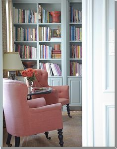 Wall of books and a pair of chairs, Carol Glasser