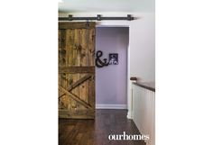 A large barn door in the living area leads to the kids' rooms. See more at http://www.ourhomes.ca/articles/build/article/rusticmodern-clutterfree-and-familyfriendly