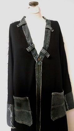 This Kimono style Jacket is made from black denim yardage and faded black recycled denim jeans.  The neckline is a denim waistband, Pockets are from jeans and binding all around as well as the sleeve cuff are from jeans. All seams fray and are on the outside.  The coat has a great shape, Im very pleased with how the pattern turned out.  This is a size large.  Measurements: taken while flat on the table neck edge to sleeve hem- 29 where neck edge meets shoulder to center front hem- 43…