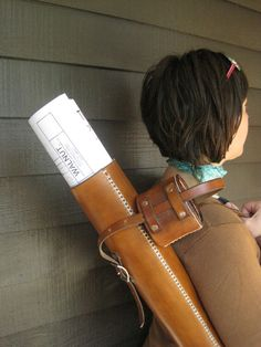 This could also be used for arrows!!! (leather blueprint carrying case from WalnutStudiolo on Etsy $199)