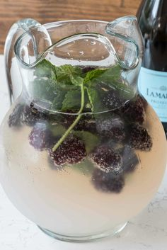 Lemonade Prosecco Punch Recipe is perfect for a summer party! Just 3 main ingredients filled with berries and mint, it goes down so easy!