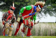 John Starr Bighorse Jr., 9, and Otto Hamilton, both dancers with the Osage Nation, perform a traditional dance at the future site of the Oklahoma Centennial Botanical Garden in Tulsa. Representatives of the Osage Nation conducted a Blessing of the Land ceremony at the site.