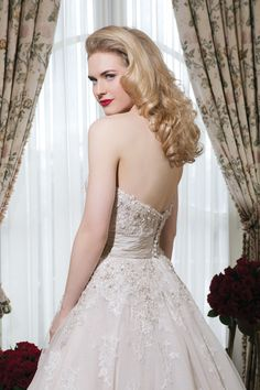 Justin Alexander wedding dresses style 8750  Tulle tea length ball gown emphasized with a strapless neckline.