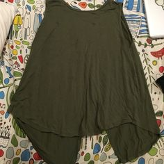 Green tank XL military green tank from old navy. Has an open back. Fall right at the waist. Has 2 stains showing in pic 3 Old Navy Tops Tank Tops